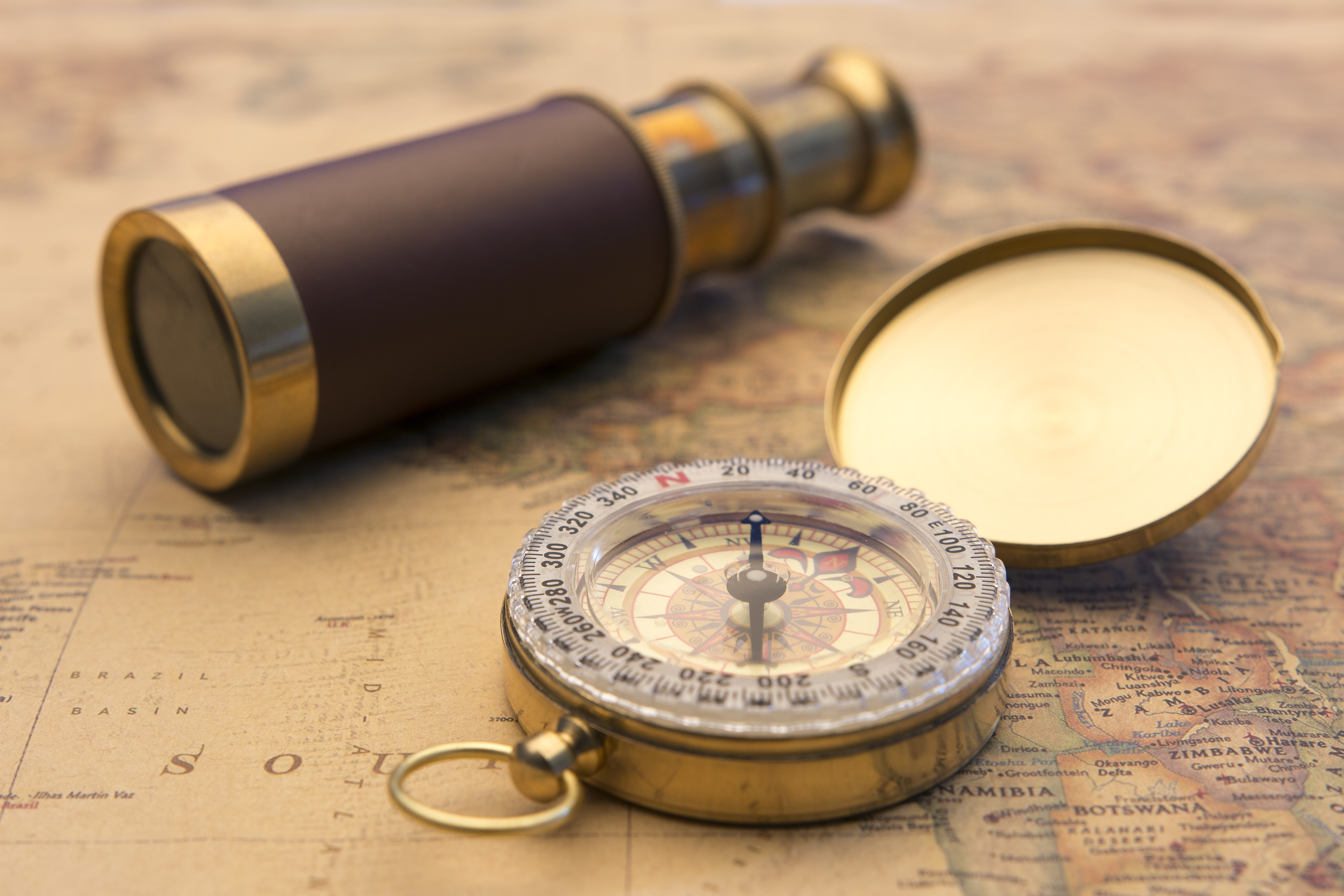 Bookkeeping Service - old compass and world map-1